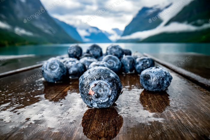 Blueberry antioxidants on a wooden table on a background of Norw