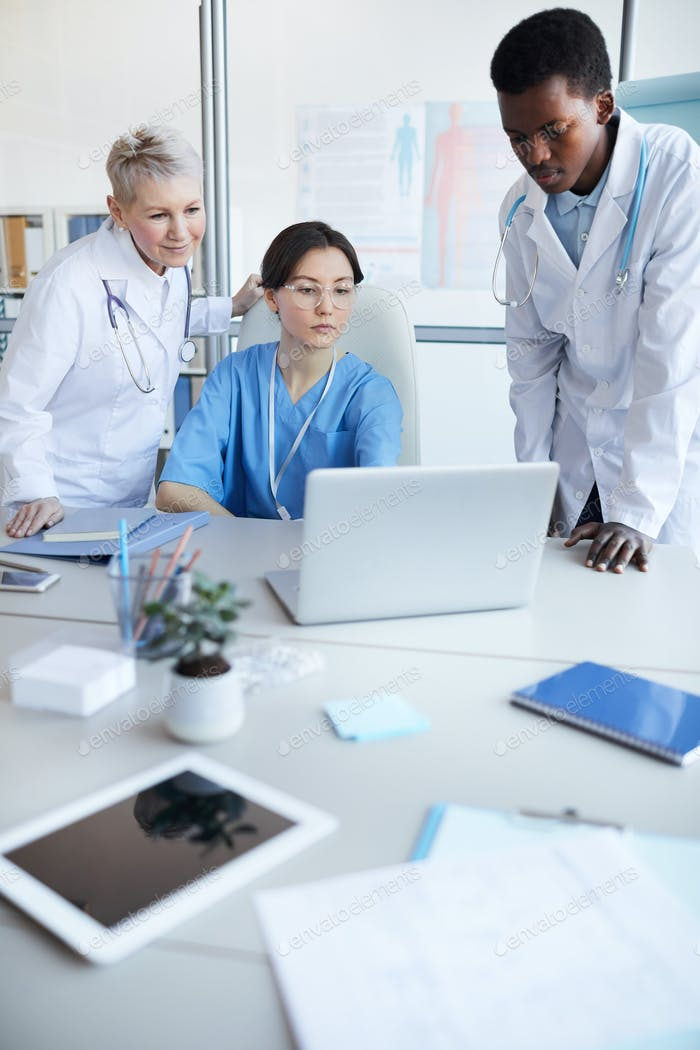 Doctors Using Computer in Clinic