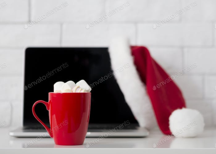 Drink hot chocolate and work on laptop, Christmas mood