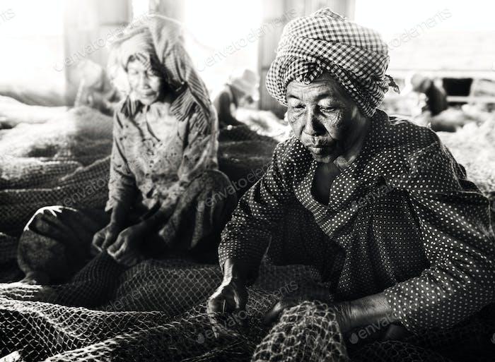 Cambodian Women Repairing Fishing Nets
