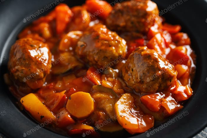 Meatballs with vegetables served on pan