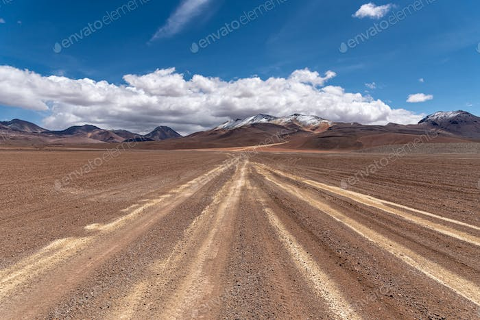 Snow mountains and empty road in the altiplano