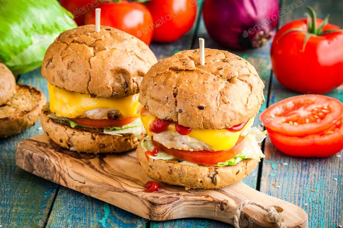 homemade chikenburgers with fresh vegetables