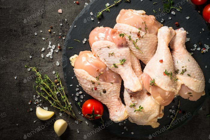 Chicken drumsticks with ingredients for cooking