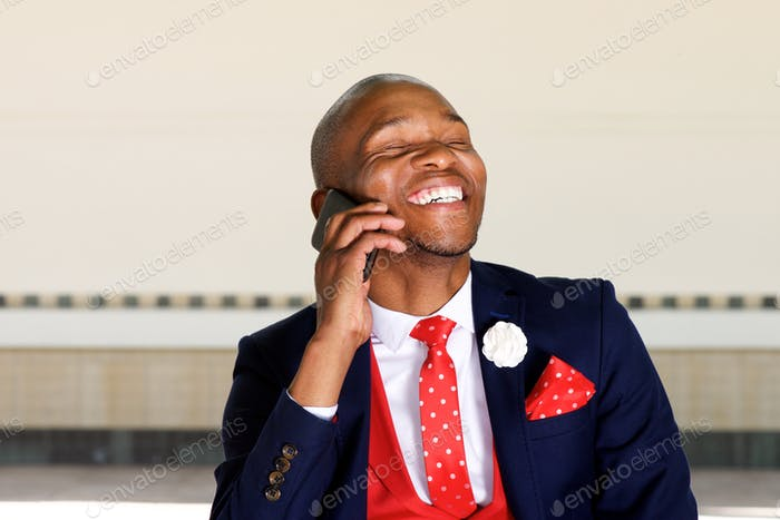 cheerful african businessman man talking on mobile phone