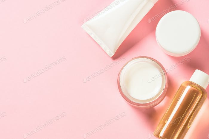 Natural cosmetic on pink flat lay