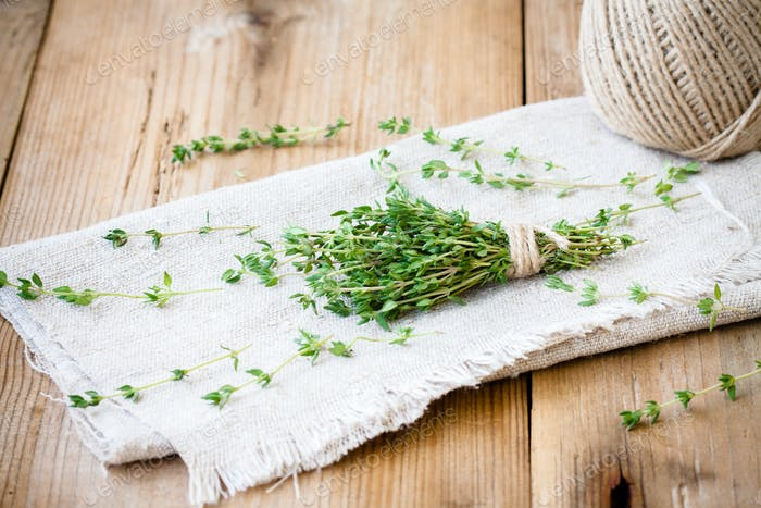 bundle of fresh thyme on sackcloth