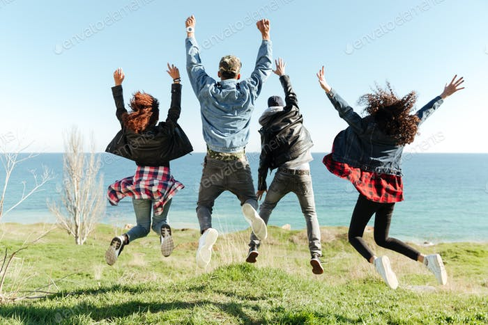 Back view picture of a group of friends jumping