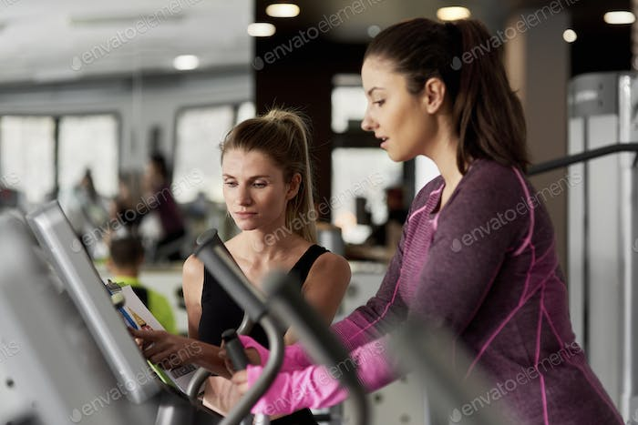 Female coach training young woman