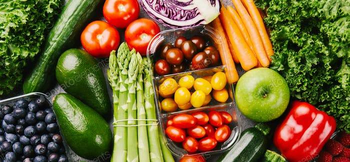 Different tasty vegetables on rough background