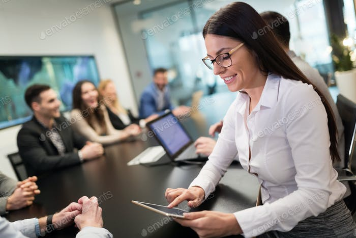 Elegant attractive businesswoman with tablet in office
