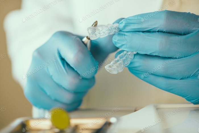 Dentist preparing Invisalign for whitening teeth