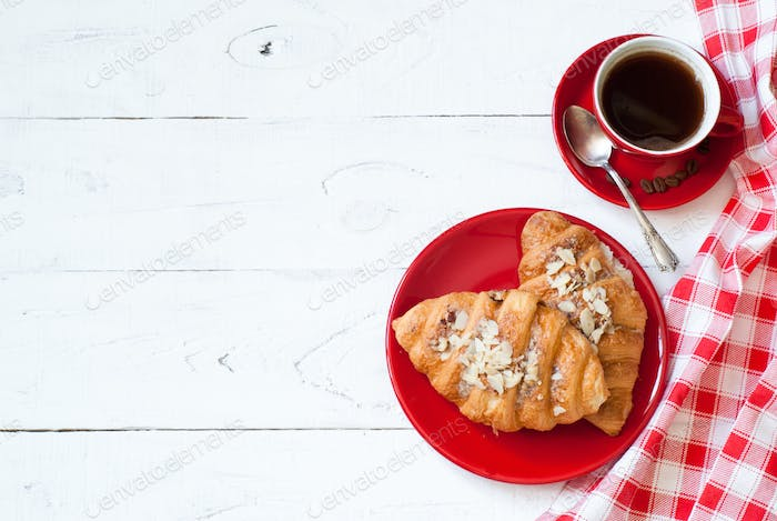 Breakfast with coffee and croissants.
