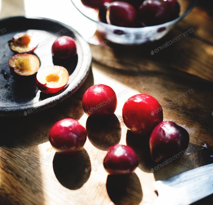 Closeup of fresh plums on wooden table