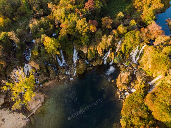 Kravica waterfall in autumn colors, aerial drone view