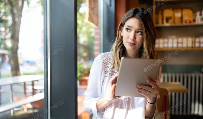 Beautiful brunette girl using laptop for work, freelance, blogging, studying, shopping