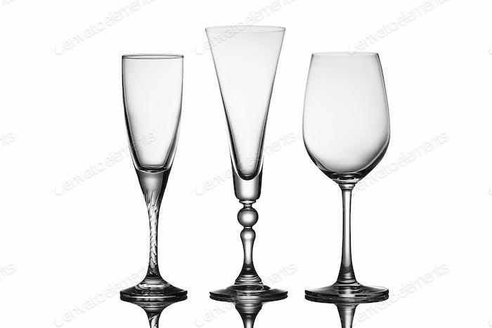 Three elegant stemmed glasses of different shapes