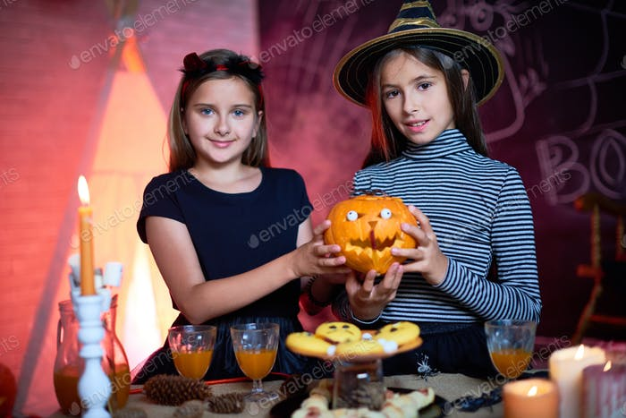 Pretty little witches with funny pumpkin