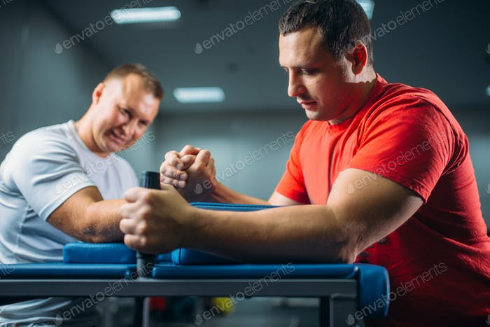 Two arm wrestlers fighting on their hands