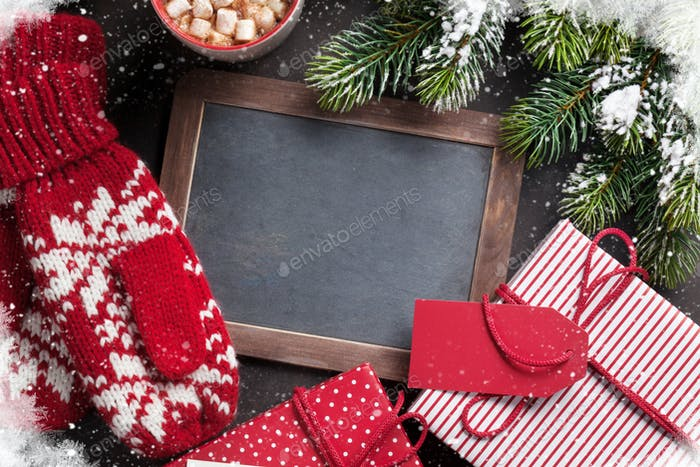 Christmas fir tree, gift, mittens and chalkboard