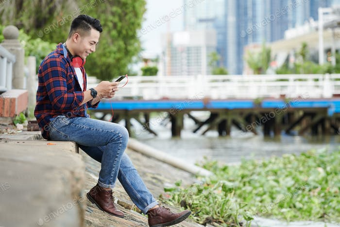 Young Vietnamese Man Chatting Online