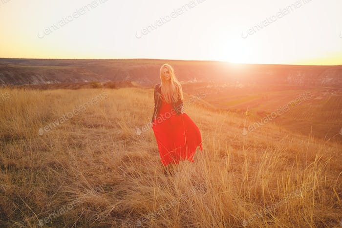 Happy woman enjoying nature sunse
