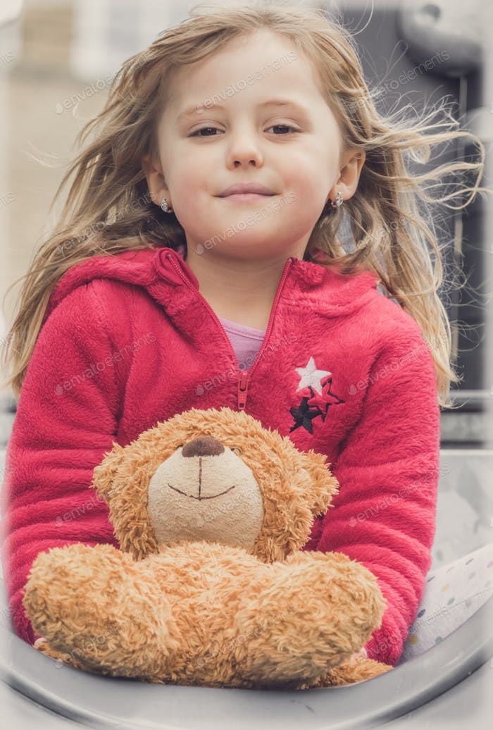 Portrait of a girl with teddy bear