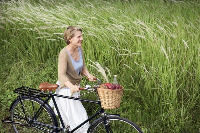 Mature woman with a bicycle