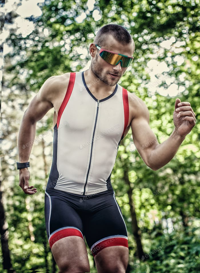 Runner man in sportswear and sunglasses