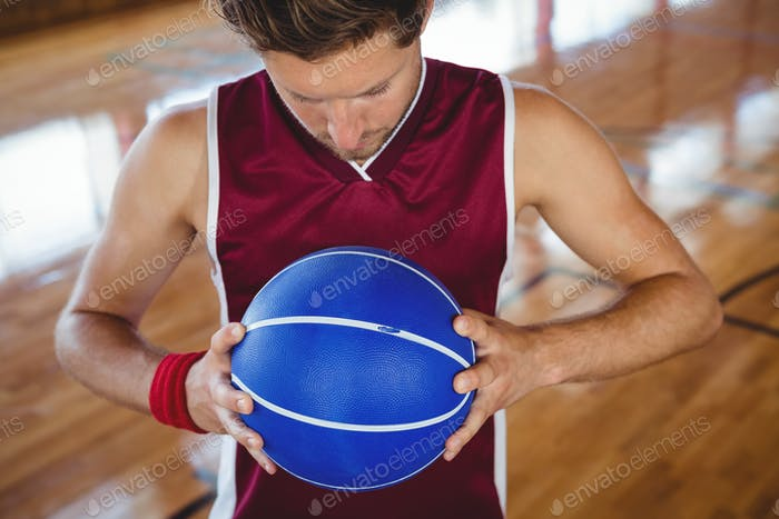High angle view of male basketball player holding ball