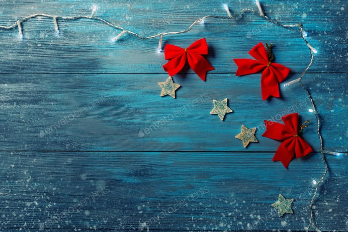 Blue wooden background and Christmas decorations.