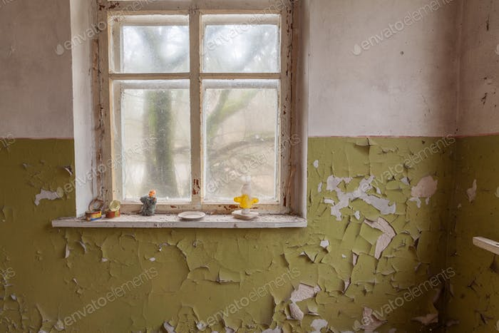 Window in old abandoned house in Chernobyl