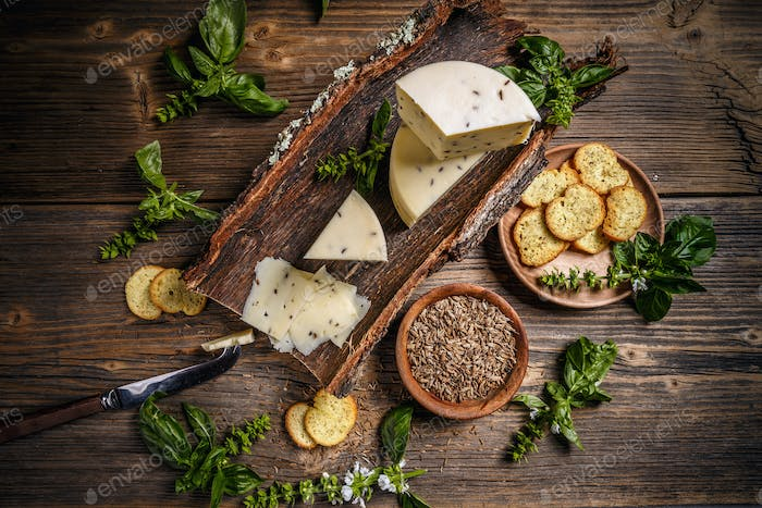 Cheese wedge with caraway seeds