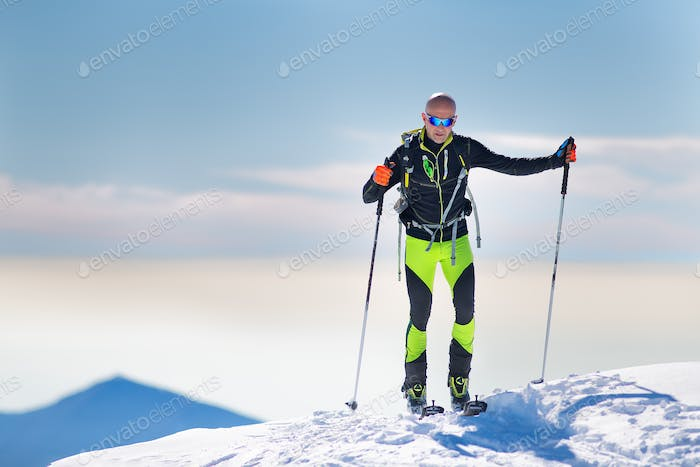 Mountaineer skier arriving at the summit