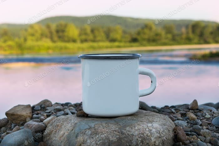 White campfire enamel mug mockup with sunrise river view