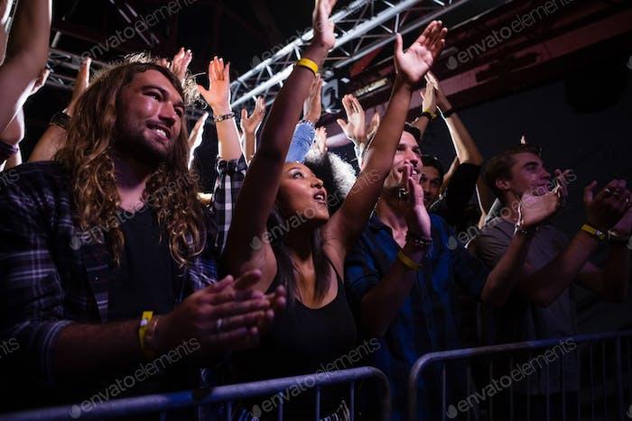 Crowd dancing and enjoying a rock concert
