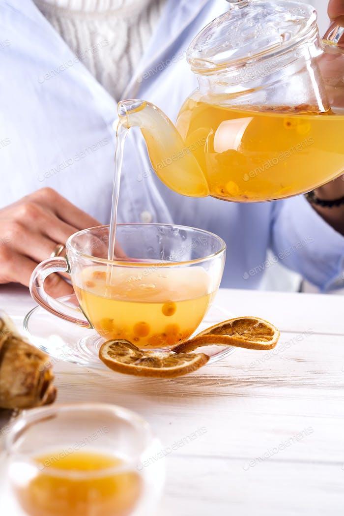 Hot herbal tea with sea buckthorn.
