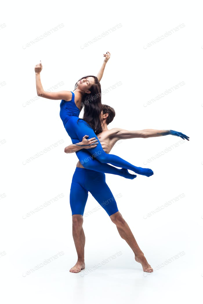 The couple of modern dancers, art contemp dance, blue and white combination of emotions