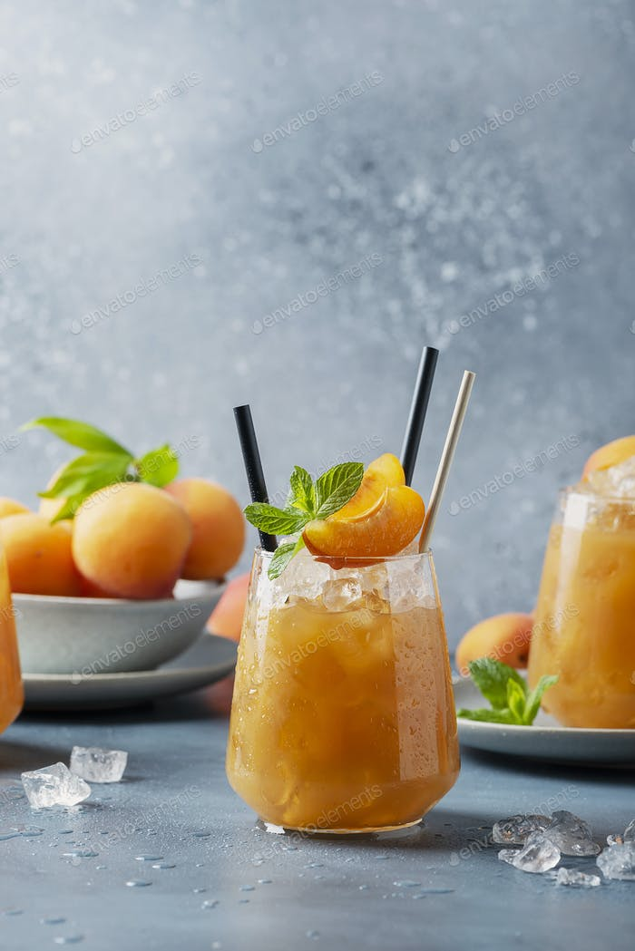 Fresh apricot cocktail with ice and mint