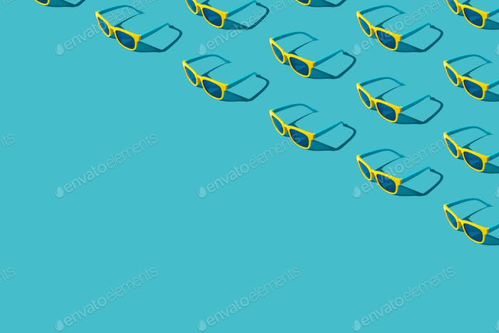Many Plastic Sunglasses On Turquoise Blue Background With Copy Space