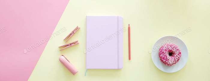 Woman's pink and yellow desk