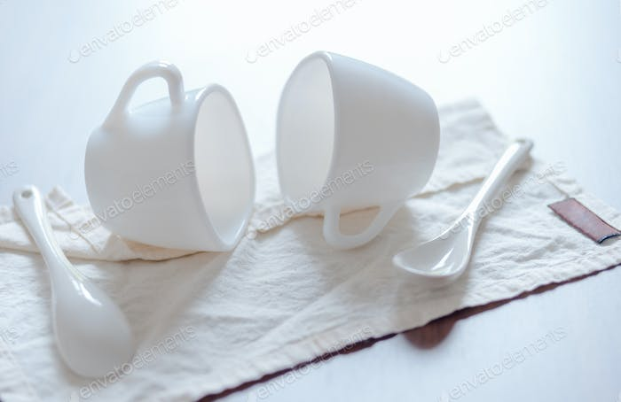 White ceramic cup and spoon on napkin