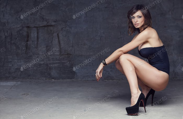 Sexual brunette woman in a lingerie.