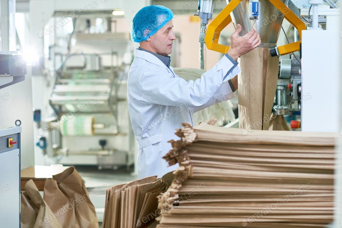 Senior Man Working at Packaging Line