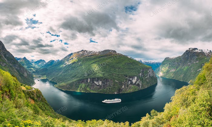 Geirangerfjord, Norway. Touristic Ship Ferry Boat Cruise Ship Liner Floating Near Geiranger In