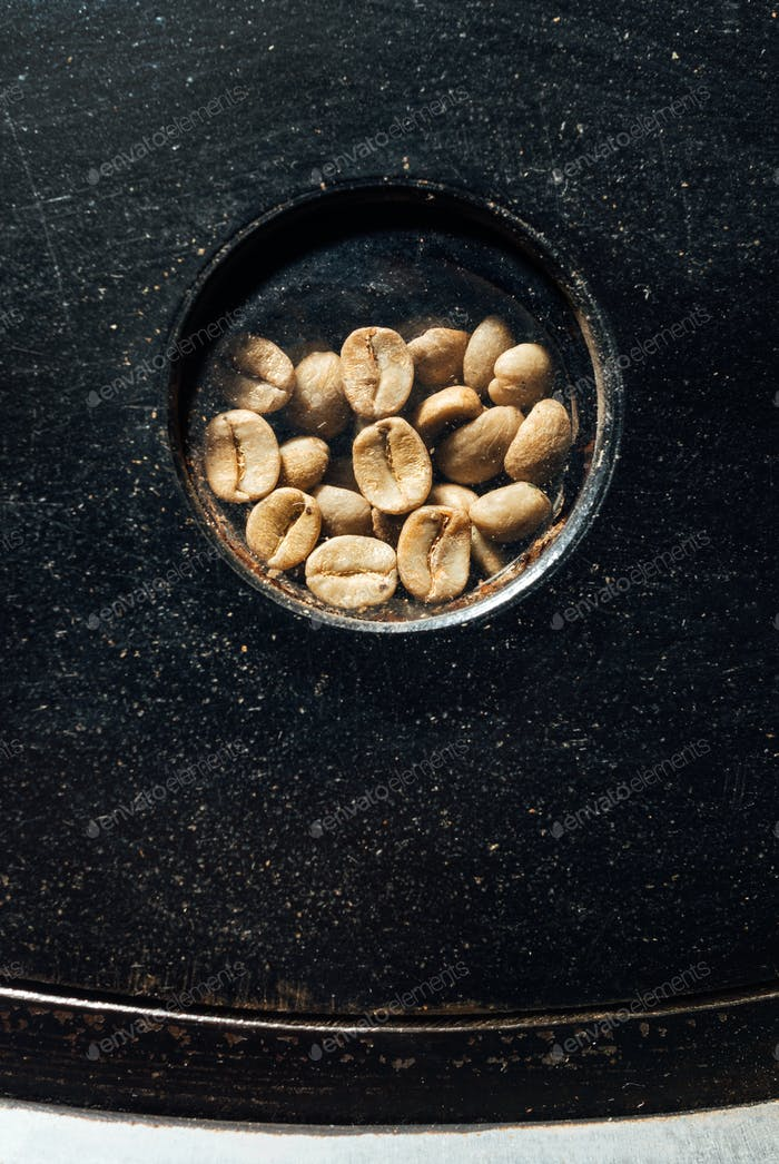 beans in a glass window in coffee roasting machine