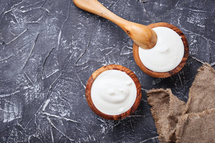 White Greek yogurt in wooden bowl