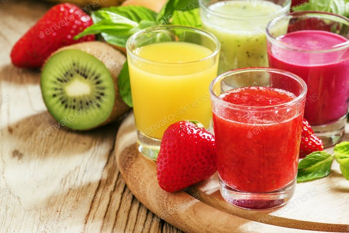 Colorful summer fruit and berry juices and smoothies