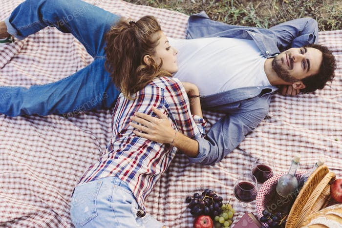 Couple doing a romantic picnic in Tuscany countryside