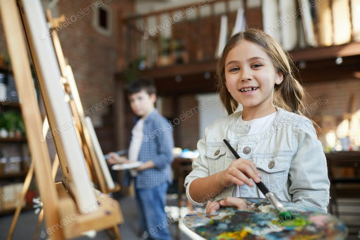 Little Girl Posing in Art Class